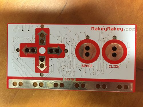The front face of the Makey Makey board
